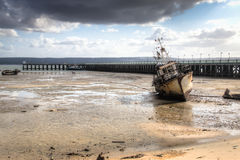The pier in the harbour of Inhambane with old boats Royalty Free Stock Images