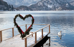 Pier and heart arch, Lake Bled, Slovenia. Beautiful winter landscape with pier and heart arch, Lake Bled, Slovenia Royalty Free Stock Photo