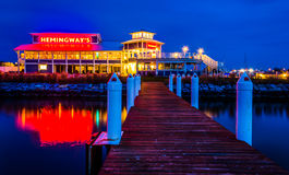 A pier and Hemingway's Restaurant at night, in Kent Island, Mary Stock Photography