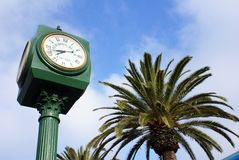 Pier at Hermosa Beach. Clock and Palm Tree at Hermosa Beach stock images