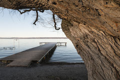 Pier at Herrsching Lake Ammersee. Pier at the Lake Ammersee in Herrsching, Bavaria royalty free stock photography