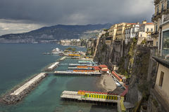 Pier and houses in Sorrento. With stormy clouds over town, Italy Royalty Free Stock Images