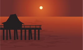 Pier and hut in sea Stock Photography