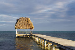Pier and Hut at Sunset Royalty Free Stock Image