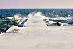 Pier in the ice in sunny day. On the northern coast of the Black Sea. Odessa, Ukraine Royalty Free Stock Images