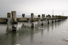 Pier with icicles at the baltic sea coast Stock Photos