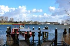 Pier at Ijsselmeer. Pier of ferry boat to open air museum in Enkhuizen, Netherlands Stock Photography