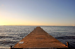 Pier im Sonnenuntergang Lizenzfreies Stockfoto