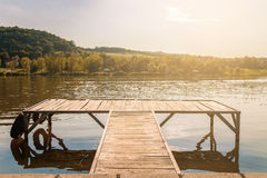 Pier In Sunset At The Lake. Royalty Free Stock Image