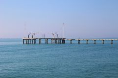 Pier on the island Lido di Venezia, Italy. Stock Images