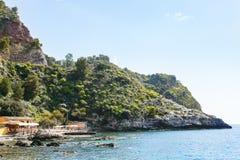 Pier on Isola Bella beach near Taormina town Royalty Free Stock Photos