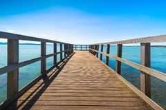 Pier or jetty, Passignano sul Trasimeno on the Trasimeno lake, U. Wooden pier or jetty, Passignano sul Trasimeno, Trasimeno lake, Umbria Italy Europe Royalty Free Stock Image
