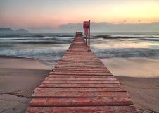 Pier / jetty playa de muro, alcudia, sunrise, mountains, secluded beach, mallorca, spain stock photography