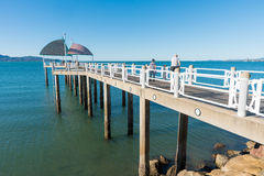 Pier / jetty on The Strand, Townsville. Families enjoying time on the jetty / pier on The Strand, Townsville, Queensland, Australia on a warm summer day Royalty Free Stock Images