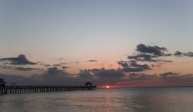 Pier jetty at sunset in Naples, forida, usa. A view in NAPLES, UNITED STATES, NOVEMBER 30, 2017 : pier jetty at sunset november 30, 2017, in Naples, Florida royalty free stock image