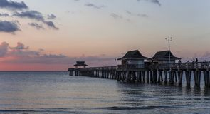 Pier jetty at sunset in Naples, forida, usa. A view in NAPLES, UNITED STATES, NOVEMBER 30, 2017 : pier jetty at sunset november 30, 2017, in Naples, Florida Royalty Free Stock Photography