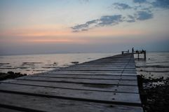The pier jutting into the sea in Kep. The pier stretching out into the ocean in the worn of kep, Cambodia Stock Photo