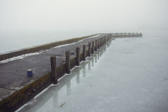 Pier in Keszthely. Fog-covered pier in the Keszthely town on Balaton lake in Hungary Royalty Free Stock Photo