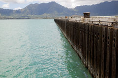 Pier with koolau mountain range Stock Photography