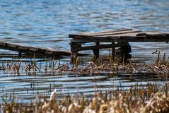 Pier. With a ladder on the lake Stock Images