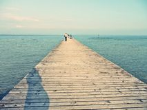 Pier in lago di garda. People walking on pier in lago di garda lake in italy Royalty Free Stock Photos