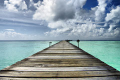 Pier in Lagoon. Endless pier in azure lagoon Royalty Free Stock Photo