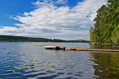 Pier on a lake Stock Image