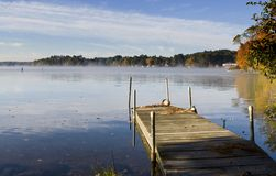 Pier on Lake. In New Hampshire during the Fall stock photos