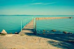 Pier on the lake Balaton. In the morning, Siófok, Hungary royalty free stock photos