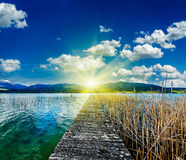 Pier in the lake in countryside Royalty Free Stock Photos