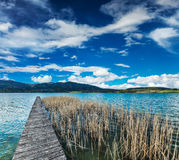 Pier in the lake in countryside Royalty Free Stock Photo