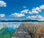 Pier in the lake in countryside Stock Photos