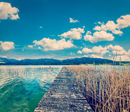 Pier in the lake in countryside Royalty Free Stock Images