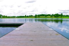 Dock by a lake royalty free stock photos