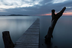 Pier on a lake at dusk Royalty Free Stock Photography