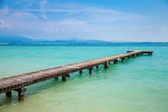 Pier at the lake Garda. Beautiful lake Garda with a long pier, Italy royalty free stock image