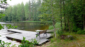 Pier at the lake. Pier on the lake next to the cottage for a weekend getaway. Lake Saimaa. Finland Stock Photo