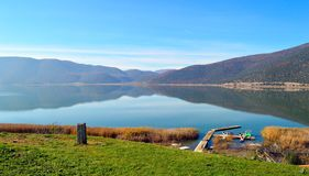 Pier in the lake. View of the Small Prespa Lake in Greece with mountain reflections and a pier Stock Photography