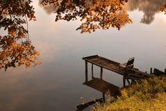 Pier on lake. Wood pier on autumn lake Royalty Free Stock Photography