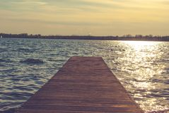 Pier on the lake. Wooden pier on the lake stock images