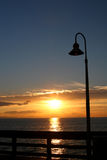 Pier Lamp Post Sunset. The setting sun is seen from the Ventura, California, Pier Stock Photography