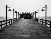 Pier with lamps in black and white Stock Photos