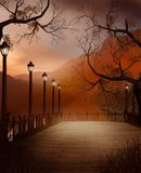 Pier with lanterns. Autumnal scenery with a pier and lanterns Royalty Free Stock Image