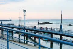 Pier in Le Croisic town, France at sunset Royalty Free Stock Photography