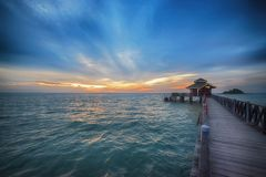 Pier leading into beautiful sunrise. A long pier leads into a beautiful sunrise off the island of Bintan near Indonesia Stock Photos