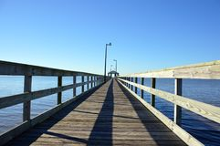 Pier to cloudless sky 2. Pier leading into a cloudless sky stock photo