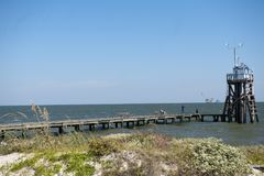 Pier at Dauphin Island in Alabama. A pier leading into the Mobile bay at the Dauphin Island in Alabama Royalty Free Stock Photos
