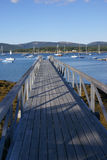 Pier leading out to harbor Stock Photography