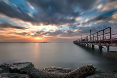 Pier leading into the sunrise. A long exposure of a sunrise creating feelings of calmness serenity and peasefulness Stock Photography