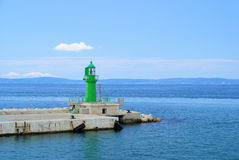 Pier and lighthouse. Adriatic Sea stock image